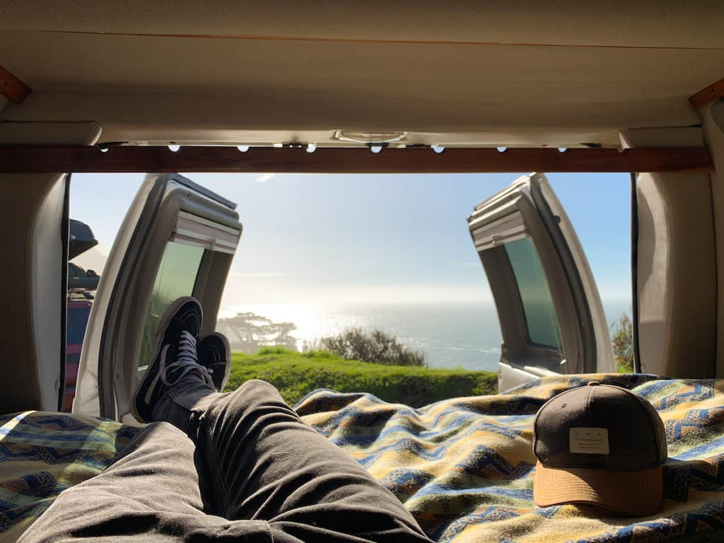 a view of the inside of my van with the open doors showing the ocean in Big Sur, California