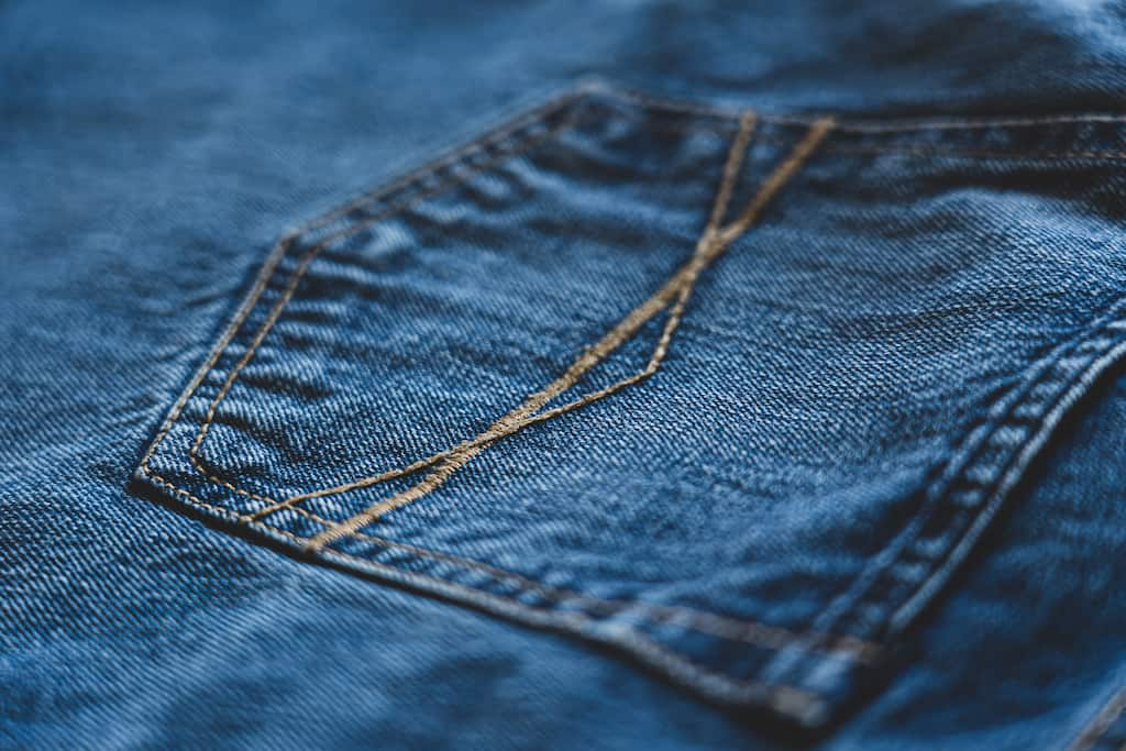 a close up of the stitching of jeans