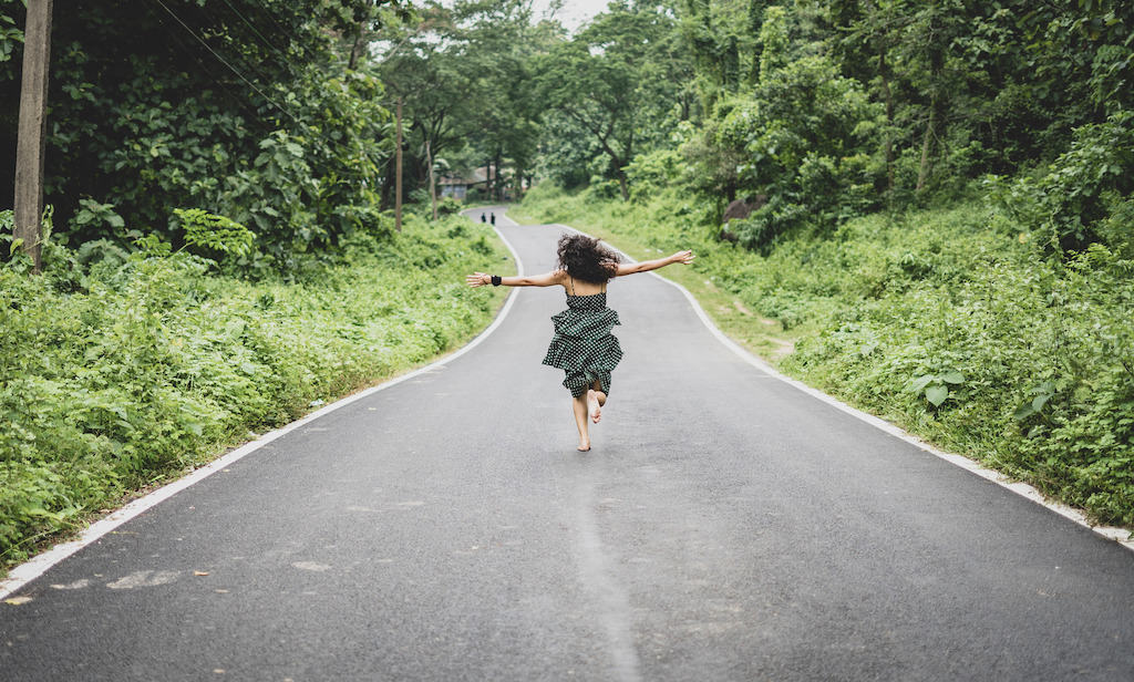 a woman running down a road