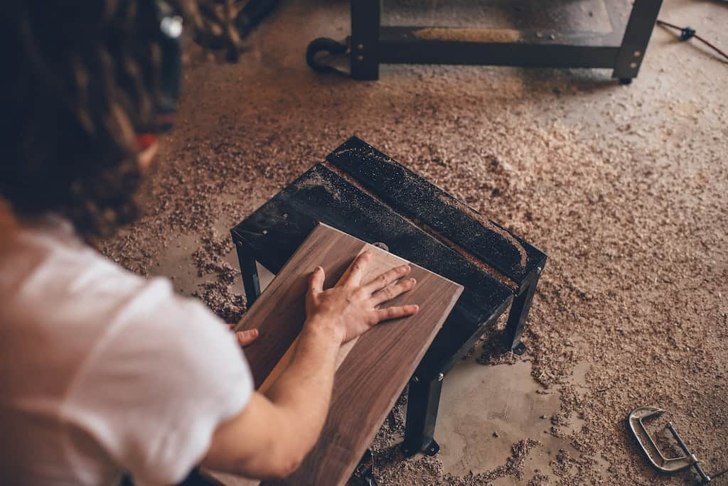 a man making a cutting board