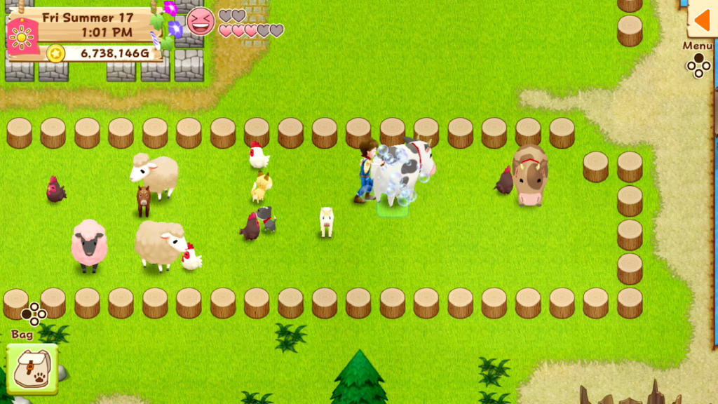 Harvest Moon gameplay with a livestock pen