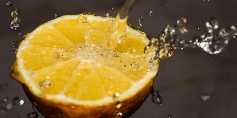Water splashing on a sliced lemon