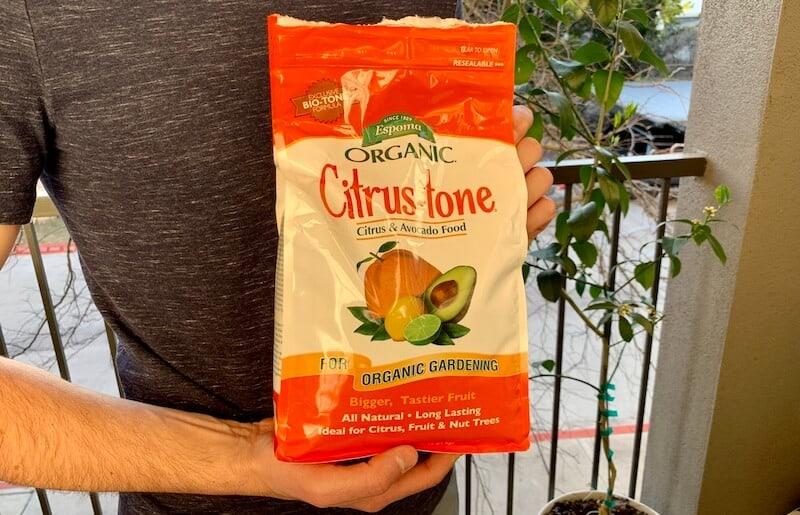 Tyler holding Espoma citrus fertilizer