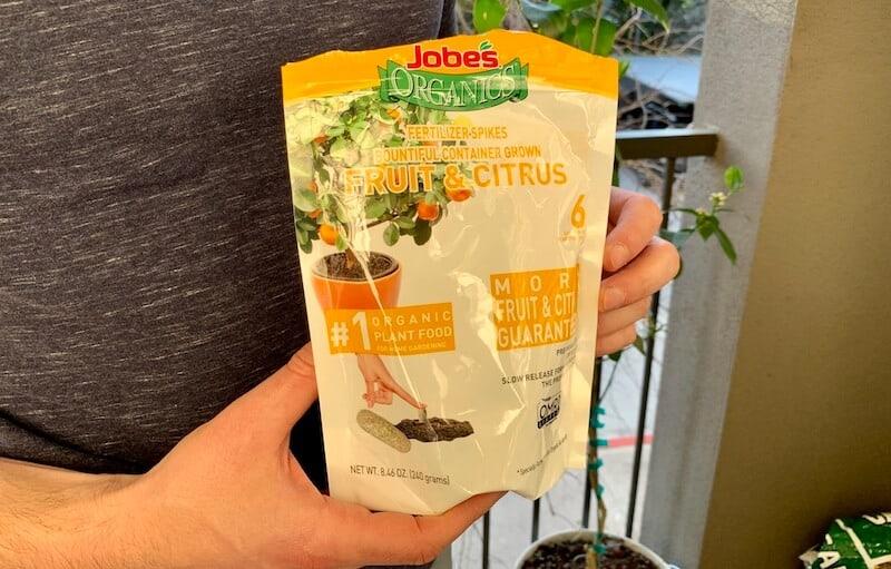 Tyler holding Jobes citrus fertilizer