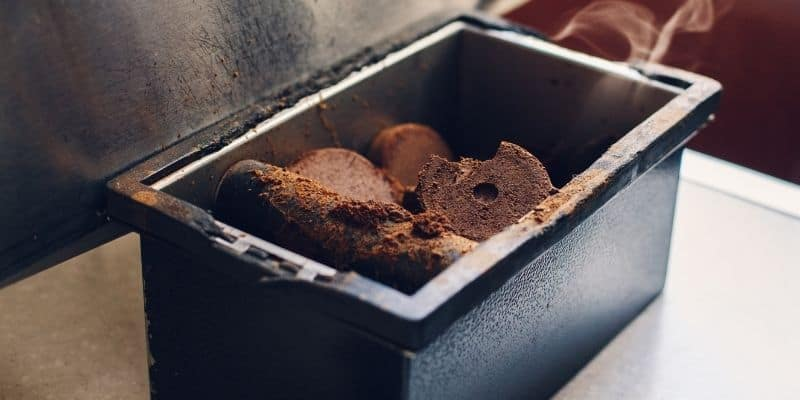 a bin of used coffee grounds from espresso