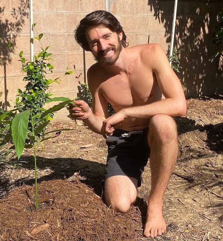 Tyler next to his avocado tree